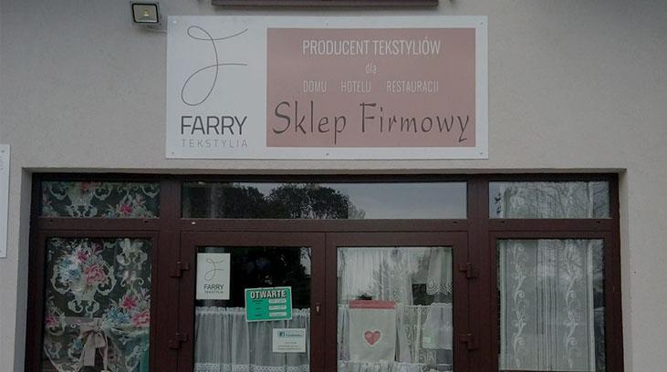 Szyld reklamowy wykonany dla Farry Tekstylia przez nasze Studio reklamy
